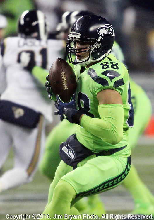 Seattle Seahawks tight end Jimmy Graham (88) turns upfield after catching a 31-yard pass from quarterback Russell Wilson to set up a 1-yard touchdown at CenturyLink Field in Seattle, Washington on December 15, 2016.  The Seahawks beat the Rams 24-3.   ©2016. Jim Bryant Photo. All Rights Reserved