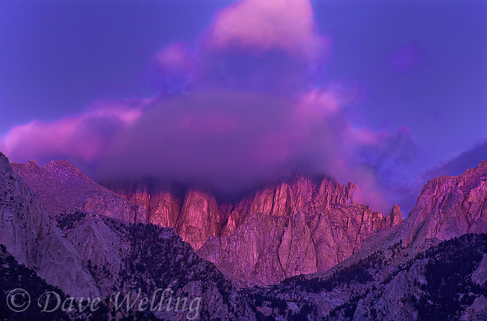 711700067 alpenglow lights up the clouds topping mount whitney in the eastern sierras near the alabama hills in california