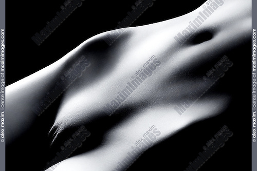 Naked woman body closeup of crotch abstract black and white fine art nude photo