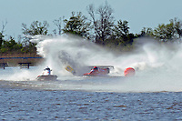 Frame 8: Terry Rinker (#10) and Chris Fairchild (#62) race up the back stright to turn 2 where Rinker's boat rolls over a wake, noses in and flips.   (Formula 1/F1/Champ class)