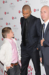 Brooklyn Beckham & Tony Parker at A Night of Fashion & Technology with LG Mobile Phones hosted by Eva Longoria & Victoria Beckham held at SoHo House in West Hollywood, California on May 24,2010                                                                   Copyright 2010  DVS / RockinExposures