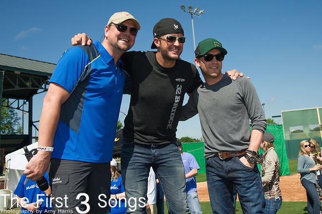 TV personality Storme Warren poses with recording artists Luke Bryan and Justin Moore at the ACM & Cabela's Great Outdoor Archery Event during the 50th Academy Of Country Music Awards at the Texas Rangers Youth Ballpark on April 18, 2015 in Arlington, Texas.