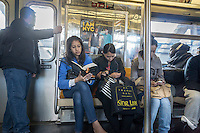 Passengers on the D train subway line in New York on Saturday, October 17, 2015. (© Richard B. Levine)
