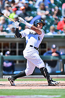 Charlotte Knights second baseman Yoan Moncada (10) swings at a pitch during a game against the  Gwinnett Braves at BB&T Ballpark on May 7, 2017 in Charlotte, North Carolina. The Knights defeated the Braves 7-1. (Tony Farlow/Four Seam Images)