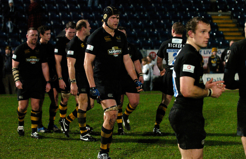 Photo: Richard Lane..London Wasps v Treviso. Heineken Cup. 10/12/2006. .Tom Palmer and his Wasps' team mates leave the field.