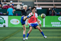 Seattle, Washington -  Sunday, September 11 2016: Seattle Reign FC forward Megan Rapinoe (15) and Seattle Reign FC midfielder Keelin Winters (11) prior to a regular season National Women's Soccer League (NWSL) match between the Seattle Reign FC and the Washington Spirit at Memorial Stadium. Seattle won 2-0.
