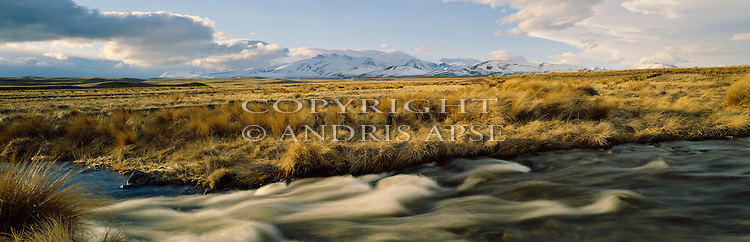 River and tussock in the Mackenzie Country. Canterbury Region. New Zealand.
