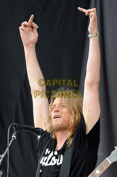 WES SCANTLIN of PUDDLE OF MUDD.performs as part of the Rock On The Range festival held at Columbus Crew Stadium,  Columbus, Ohio, USA, .22nd May 2010..music gig live on stage  concert half length black t-shirt  arms raised up microphone .CAP/ADM/JN.©Jason L Nelson/AdMedia/Capital Pictures.