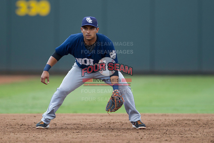 New Orleans Zephyrs third baseman Donovan Solano (17) on defense during the Pacific Coast League baseball game against the Round Rock Express on June 30, 2013 at the Dell Diamond in Round Rock, Texas. Round Rock defeated New Orleans 5-1. (Andrew Woolley/Four Seam Images)