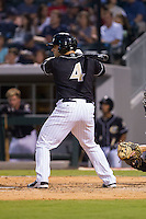 Josh Phegley (4) of the Charlotte Knights at bat against the Pawtucket Red Sox at BB&T Ballpark on August 9, 2014 in Charlotte, North Carolina.  The Red Sox defeated the Knights  5-2.  (Brian Westerholt/Four Seam Images)