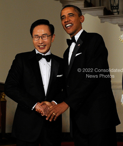 United States President Barack Obama shakes hands with South Korean President Lee Myung-bak in the Cross Hall as they arrive for a State Dinner at the White House in Washington, DC on Thursday, October 13, 2011. The State Visit comes only a day after congress passed a free trade agreement with South Korea.  .Credit: Roger L. Wollenberg / Pool via CNP