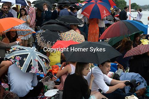 Henley on Thames Royal Regatta. UK. Picnic in the English summer raining.