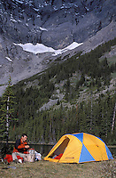 CANADA, ALBERTA, KANANASKIS, MAY 2002.  A hiker camps at Evan Thomas Lake. The Kananaskis Country provincial park is home to Canada's most beautiful nature and wildlife. It has also escaped the mass tourism as in Banff National Park. Photo by Frits Meyst/Adventure4ever.com