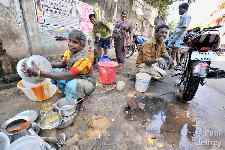 People gather at a water source in the Chepet neighborhood of Chennai, a city in the southern India state of Tamil Nadu.