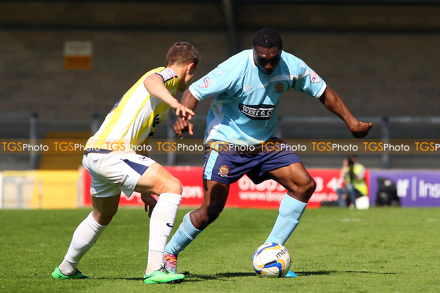 Femi Ilesanmi of Dagenham and Redbridge and Billy Bodin of Torquay United - Torquay United vs Dagenham and Redbridge, Sky Bet League Two Football at the Plainmoor Stadium - 18/04/14 - MANDATORY CREDIT: Dave Simpson/TGSPHOTO - Self billing applies where appropriate - 0845 094 6026 - contact@tgsphoto.co.uk - NO UNPAID USE