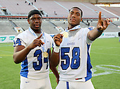 Armwood Hawks tight end Kyron Miles #34 and defensive lineman Byron Cowart #58 pose after the Florida High School Athletic Association 6A Championship Game at Florida's Citrus Bowl on December 17, 2011 in Orlando, Florida.  Armwood defeated Miami Central 40-31.  (Photo By Mike Janes Photography)
