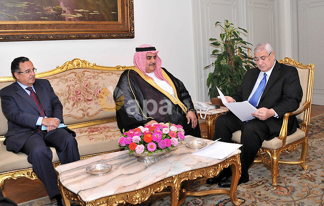 In this handout picture released by the Egyptian Presidency, Bahrain Foreign Affairs Minister Sheikh Khaled bin Ahmed al-Khalifa meets with Egypt's interim president Adly Mansour on September 2, 2013 in Cairo. Photo by Ahmed Asad