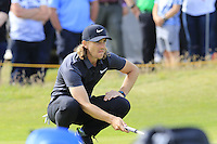 Tommy Fleetwood (ENG) lines up his birdie putt on the 14th green during Thursday's Round 1 of the 145th Open Championship held at Royal Troon Golf Club, Troon, Ayreshire, Scotland. 14th July 2016.<br /> Picture: Eoin Clarke | Golffile<br /> <br /> <br /> All photos usage must carry mandatory copyright credit (&copy; Golffile | Eoin Clarke)