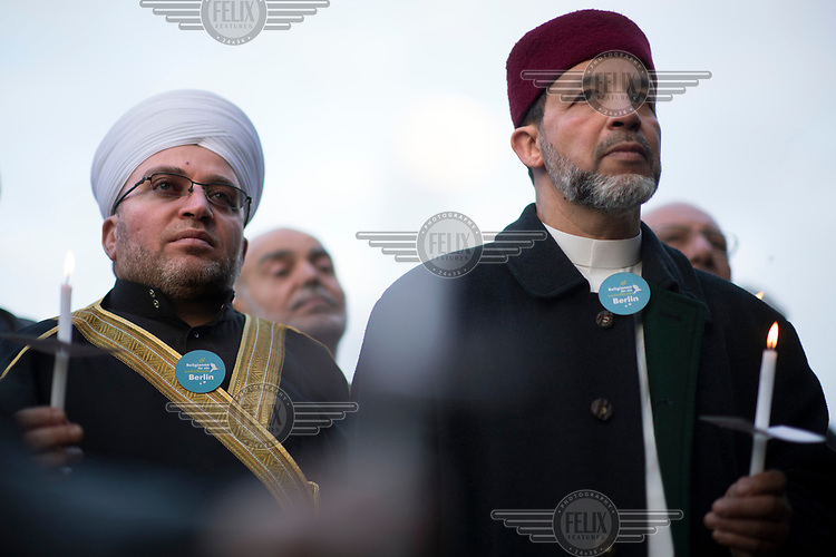 Mohamed Taha Sabri, Imam of the Dar-Assalam Mosque in Neukoelln (right), during a peace rally with the slogan 'Religionen fuer ein weltoffenes Berlin' (Religions for a an open Berlin). It was held in memory of the victims of the Breitscheidtplatz Christmas market terror attack.