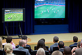 United States President Barack Obama, center right, watches the USA v. Belgium World Cup game with staff members at the Eisenhower Executive Office Building next to the White House in Washington, D.C., U.S., on Tuesday, July 1, 2014. The U.S. is tied 0-0 with Belgium in a match to decide who meets Argentina in the quarterfinals of soccer's World Cup in Brazil. <br /> Credit: Andrew Harrer / Pool via CNP