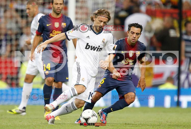Real Madrid's Luka Modric against Barcelona's Xavi Hernandez during Super Cup match. August 29, 2012. (ALTERPHOTOS/Alvaro Hernandez). /NortePhoto.com<br /> <br /> **CREDITO*OBLIGATORIO** <br /> *No*Venta*A*Terceros*<br /> *No*Sale*So*third*<br /> *** No*Se*Permite*Hacer*Archivo**<br /> *No*Sale*So*third*