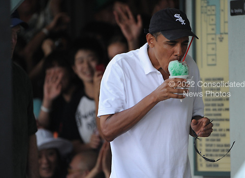 United States President Barack Obama enjoys shave ice at Island Snow in Kailua, Hawaii, Monday, January 3, 2011..Credit: Cory Lum / Pool via CNP