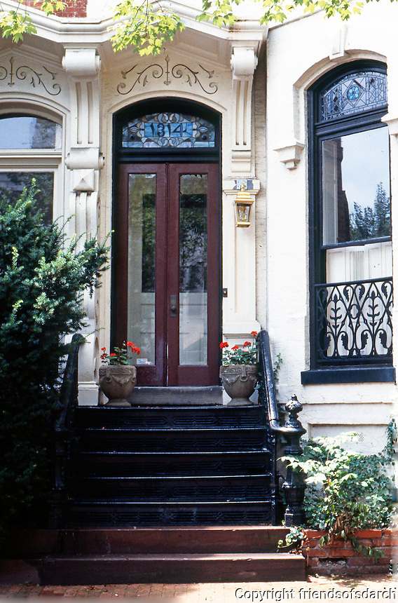 D.C.: Georgetown--Entrance, 1868. Grafton-Tyler Double House, 1312-1314 30th NW. Note: 8 ft. high window, elaborate hood & capstone, cast-iron stoop railings. Photo '85.