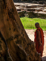 "Buddhist Monk visiting Preah Khan in the Angkor Wat temple area Preah Khan was built on the site of Jayavarman VII's victory over the invading Chams in 1191. Unusually the modern name, meaning ""holy sword"", is derived from the meaning of the original—Nagara Jayasri (holy city of victory). The site may previously have been occupied by the royal palaces of Yasovarman II and Tribhuvanadityavarman."
