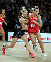 27.08.2016 Silver Ferns Katrina Grant and England's Jo Harten in action during the Netball Quad Series match between teh Silver Ferns and England at Vector Arena in Auckland. Mandatory Photo Credit ©Michael Bradley.