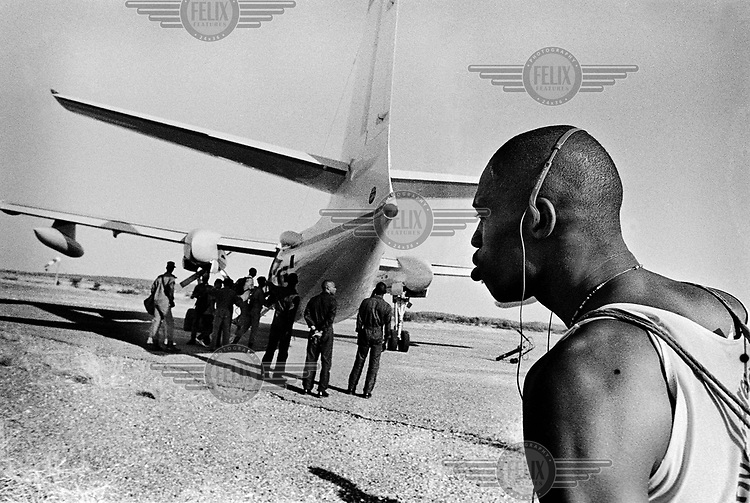 Cyclists boarding an aeroplane to travel from Bakel to St. Louis..The Tour du Senegal, a two-week cycle race held in average temperatures of 40 degrees Celsius, traverses the country with a total distance of 1168km.