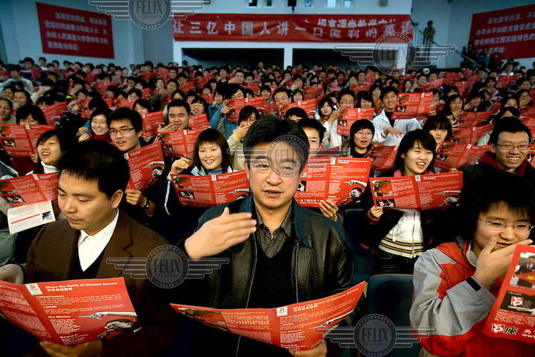 """Students and teachers study """"Crazy English"""" at the Petrochemical University in Beijing, as part of the city's effort to get ready to host the 2008 Olympic Games."""