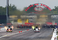 Aug 31, 2019; Clermont, IN, USA; NHRA top fuel driver Brittany Force (left) races alongside Steve Torrence during qualifying for the US Nationals at Lucas Oil Raceway. Mandatory Credit: Mark J. Rebilas-USA TODAY Sports