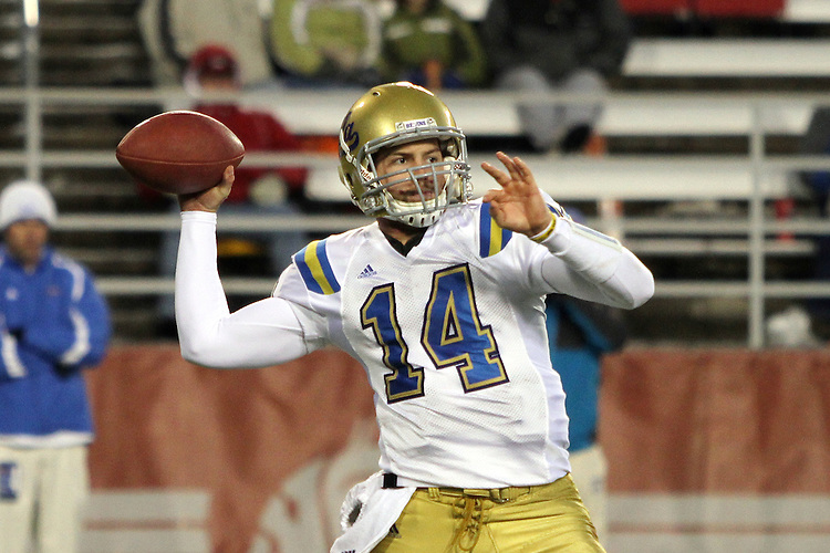 UCLA quarterback, Kevin Prince (#14), prepares to fire a pass during UCLA's 43-7 Pac-10 conference road victory over Washington State at Martin Stadium in Pullman, Washington, on November 14, 2009.