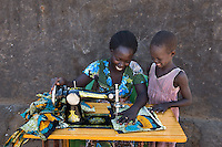 BRAC PROJECT, Abau Flora (26), BRAC sponsored tailoring, gave her sewing machine and training. Has three kids, her husband is a day laborer. Makes about $80 per month.