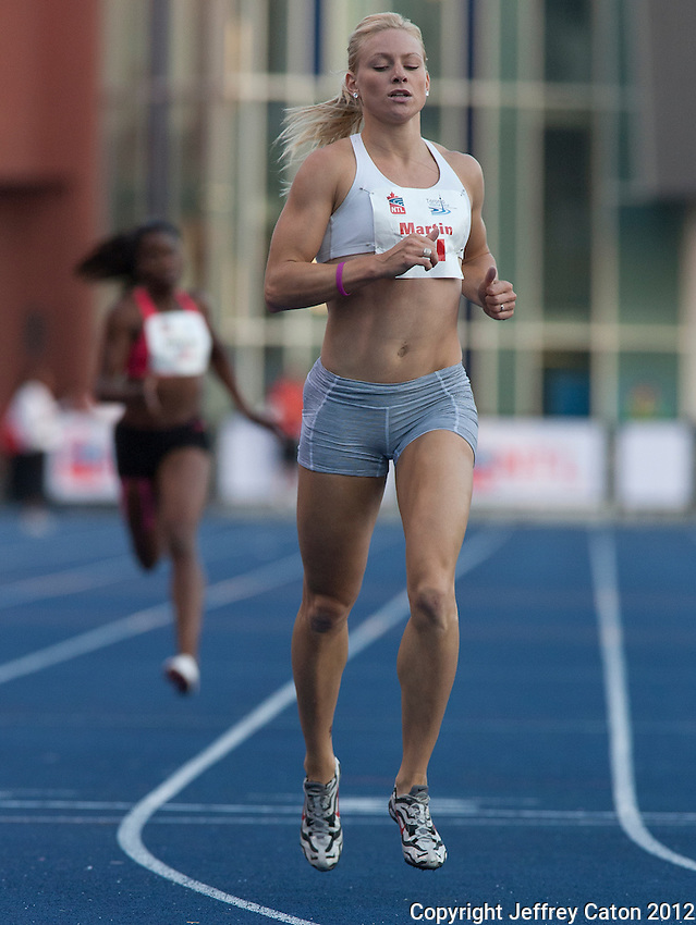 11/07/12 8:24:14 PM Canadian Olympian Jenna Martin winning the women's 400m race at the 2012 Toronto International Track and Field Games---Toronto, ON, Canada:  Sports Action.  Photo by Jeffrey Caton