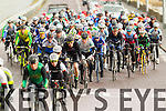 Riders pass through Blennerville at the start of the Lacey Cup cycle race on Sunday.