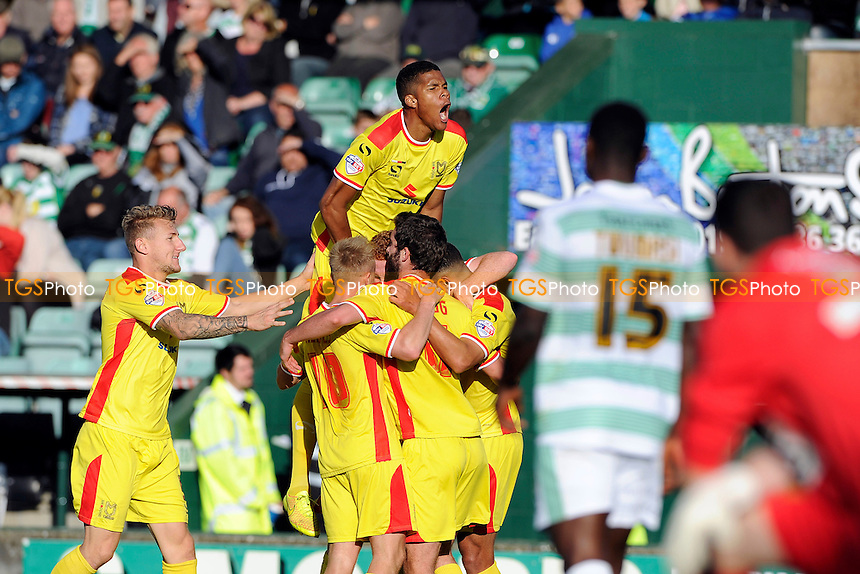MK Dons players celebrate their second goal scored by Daniel Powell of MK Dons - Yeovil Town vs Mlton Keynes Dons - Sky Bet League One Football at Huish Park, Yeovil - 04/10/14 - MANDATORY CREDIT: Denis Murphy/TGSPHOTO - Self billing applies where appropriate - contact@tgsphoto.co.uk - NO UNPAID USE
