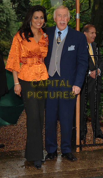 WILNELIA MERCED FORSYTH & BRUCE FORSYTH..Attending David Frost's Summer Party, at Sir David Frost's private residence in London, England, July 9, 2008...full length blue suit married husband wife orange top trousers black tie ..CAP/WIZ..©Wizard/Capital Pictures