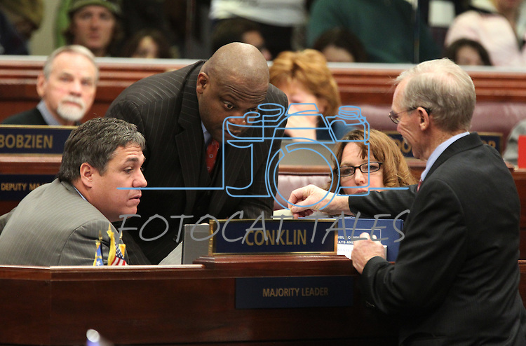 Nevada Assembly Democrats, from left, Marcus Conklin, William Horne and Marilyn Kirkpatrick read a note from Sgt. at Arms Terry Sullivan during the floor session at the Legislature in Carson City, Nev., on Monday, March 21, 2011. Photo by Cathleen Allison