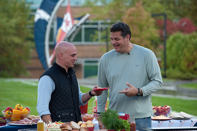 "October  14, 2011 - Bristol, CT - Campus Green: ABC's ""The Chew"" Chef Michael Symon with Mike and Mike in the Morning's Mike Golic.  . .Credit: Joe Faraoni"
