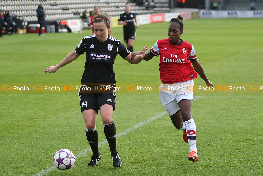 Rachel Corsie of Glasgow City Ladies holds off Danielle Carter of Arsenal Ladies - Arsenal Ladies vs Glasgow City LFC - UEFA Womens Champions League Round of 16 First Leg Football at the Hive Stadium, Barnet FC, London - 09/11/13 - MANDATORY CREDIT: George Phillipou/TGSPHOTO - Self billing applies where appropriate - 0845 094 6026 - contact@tgsphoto.co.uk - NO UNPAID USE