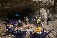NWA Democrat-Gazette/BEN GOFF @NWABENGOFF<br /> Guest hang out Saturday, Nov. 3, 2018, during the first public 'Cave Party' at Hole in the Wall NWA in Bella Vista. Guests to the free event had a chance to check out the cave while enjoying food, live music, campfires and stargazing with Explore Scientific USA. Overnight camping was also offered with a reservation. Owners Julie Duncan and Duane Paterson purchased the property three years ago with the idea of building their dream home, but are now trying to make the property a camping and event space. The 12 acre property with a cave, open meadow and woods sits only a short distance from a future addition to the Back 40 mountain bike trail system.