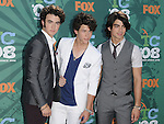 Kevin, Nick and Joe Jonas of the Jonas Brothers at the Teen Choice Awards 2008 arrivals at the Gibson amphitheatre at Universal City Walk, Ca. August 3, 2008. Fitzroy Barrett