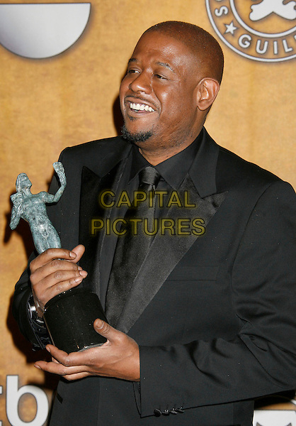 "FOREST WHITAKER.winner of the ""Male Actor In A Leading Role"" award for ""The Last King of Scotland"".13th Annual Screen Actors Guild (SAG) Awards held at the Shrine Auditorium - pressroom,  Los Angeles, California, USA, 28 January 2007..press room half length award trophy black suit.CAP/ADM/RE.©Russ Elliot/AdMedia/Capital Pictures."