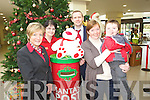 Staff from Murphys Supervalu Martina O'Sullivan, Aine Kelliher, Dermot Hartigan with customers Julie and James Harrington at Santas postbox in the Kenmare shopping centre on Friday.