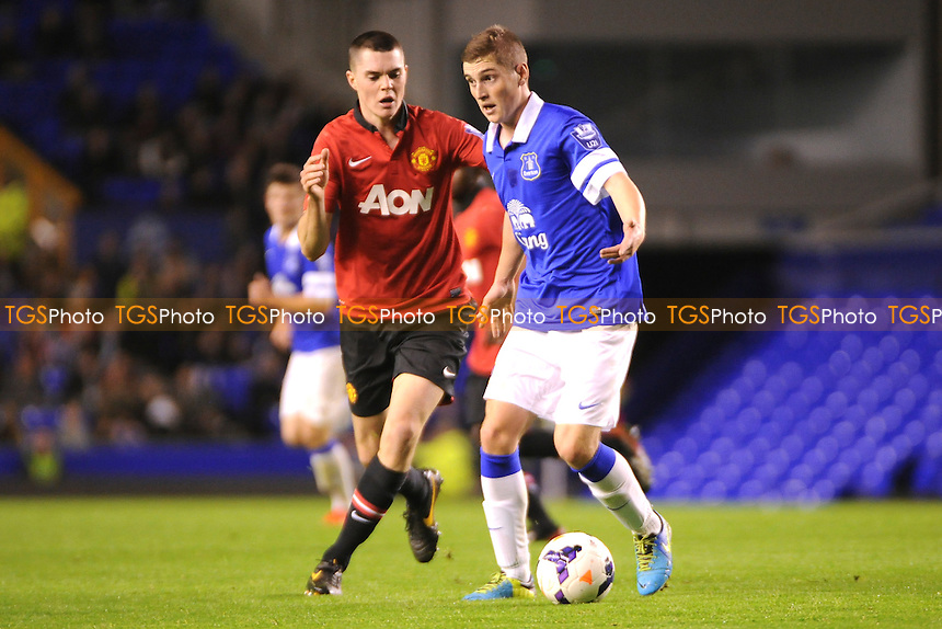Conor Grant of Everton holds off Michael Keane of Manchester United - Everton Under-21 vs Manchester United Under-21 - Barclays Under-21 Premier League Football at Goodison Park, Liverpool - 21/10/13 - MANDATORY CREDIT: Greig Bertram/TGSPHOTO - Self billing applies where appropriate - 0845 094 6026 - contact@tgsphoto.co.uk - NO UNPAID USE