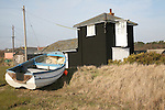 Boathouse and fishing boat, Sizewell, Suffolk, England