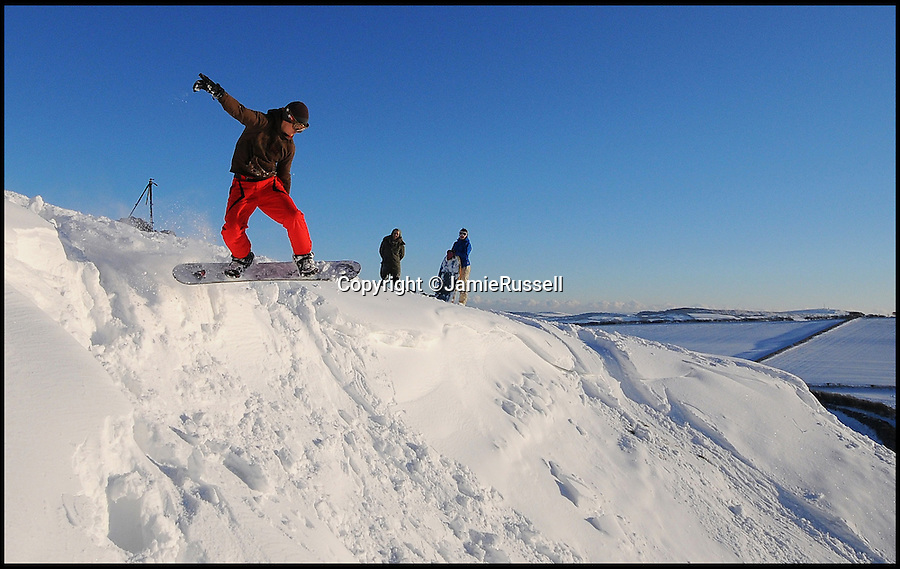 BNPS.co.uk (01202 558833)<br /> Pic: JamieRussell/BNPS<br /> <br /> ***Please Use Full Byline***<br /> <br /> Snowboarding at Chillerton. <br /> <br /> Stunning photographs have revealed a turbulent side to the normally genteel Isle of Wight.<br /> <br /> The seemingly benign south coast holiday destination has been catalogued over a stormy year by local photographer Jamie Russell, and his astonishing pictures reveal the dramatic changes in weather that roll across the UK in just 12 months.<br /> <br /> Lightning storms, ice, floods, gales and blizzards have all been captured by the intrepid photographer who frequently got up in the middle of the night to capture the climatic chaos.<br /> <br /> Looking at these pictures prospective holidaymakers could be forgiven for thinking twice about a gentle staycation on the south coast island.