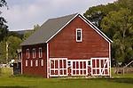Red barn in field in central Colorado.