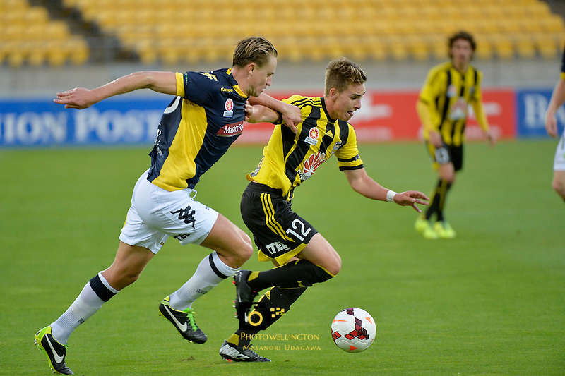 Tyler Boyd and Zachary Anderson in action during the A League - Wellington Phoenix v Central Coast Mariners at Westpac Stadium, Wellington, New Zealand on Sunday 12  January 2014.<br /> Photo by Masanori Udagawa.<br /> www.photowellington.photoshelter.com